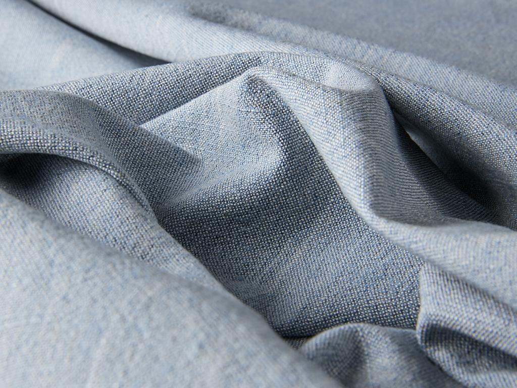 detail of texture of natural lucca fabric for drapery and furniture