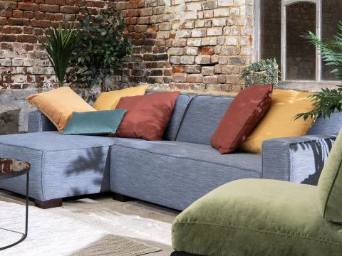 sofa with blue structured atlantis upholstery fabric